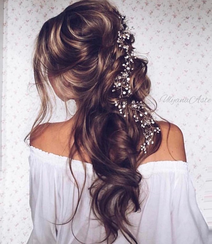 If you can't decide between wearing your hair up or down, go with a half-up, ethereal style. To copy this stunning 'do, curl your hair first (add extensions if you need a little help in the length department), tease it for added volume, and then sweep it back and secure it before adding in baby's breath.