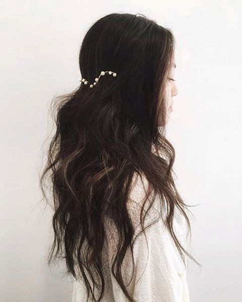 For the chic, modern bride, create super-loose waves and then add a bit of elegance to the back of your style with a pearl headpiece.