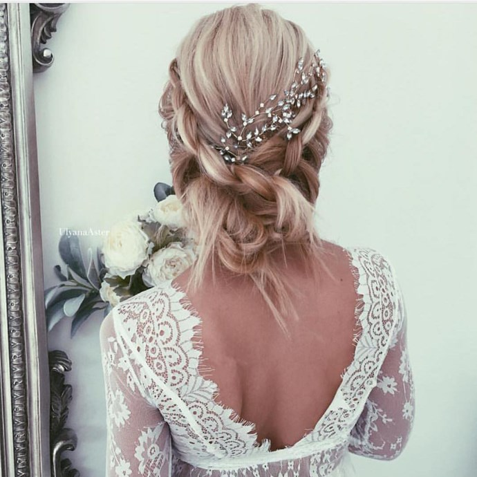 To keep a loose style like this secure for the whole wedding, tightly braid the hair first. Then, go back and gently tug the braid apart to give it the appearance of being loose without it actually unraveling.