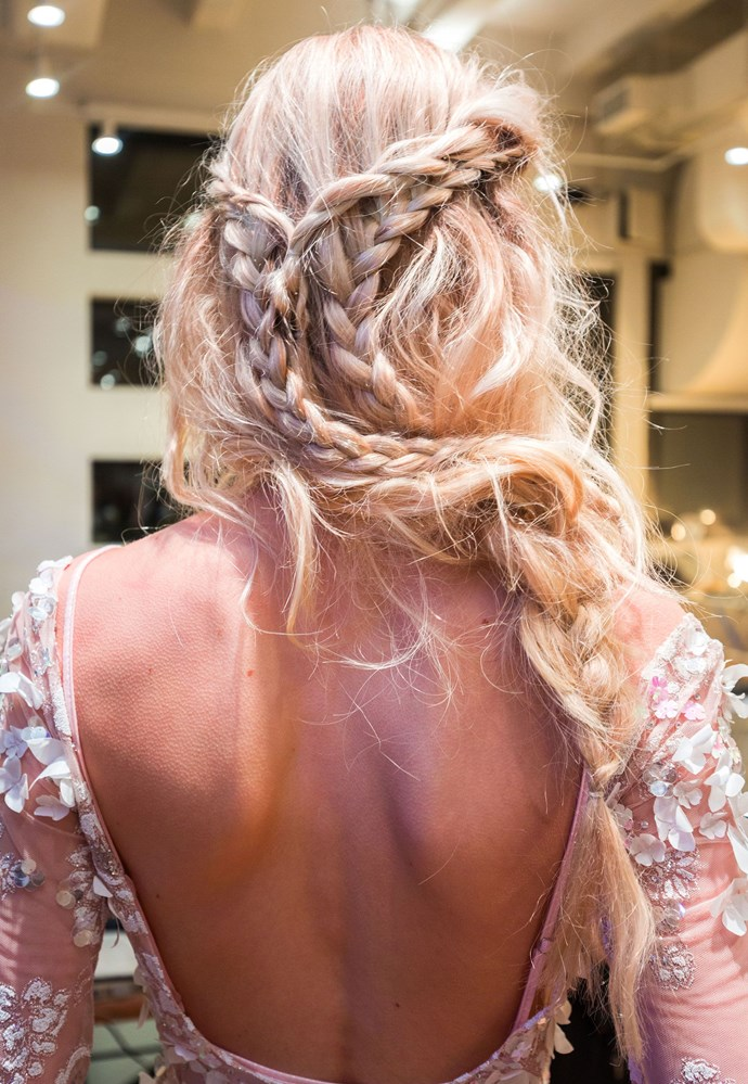 This braided style from the JLM Couture show is for the chill bride who lists Blake Lively as her hair idol. To recreate the look, add a wavy texture into your hair with a curling or flat iron, and then create several braids from your temples, along your hairline, connecting them in the back.