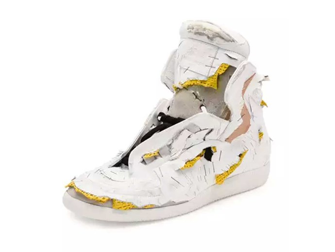 Another day, another abso-fuckling-lutely RIDIC fashion piece makes its way onto the market. Behold: the [shredded sneaker](http://www.neimanmarcus.com/en-au/Maison-Margiela-Future-Destroyed-High-Top-Sneaker-White-Yellow/prod192370016/p.prod). That's right, for the humble price of $2,040 you too can look like you've been attacked by a pack of rabid dogs. Y'now, if you're that way inclined...