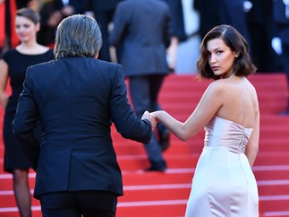 Bella Hadid just handled this devastating wardrobe malfunction at Cannes like a total pro