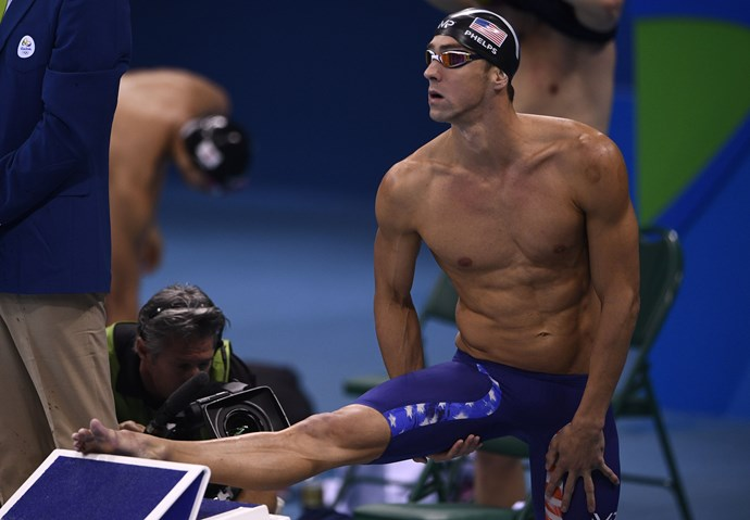 Michael Phelps is going to race a Great White Shark and we don't really understand why