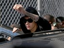 Justin Bieber has struck a paparazzo with his car outside Hillsong Church, police say