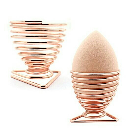 **The Beauty Blender holder** <br> <br> An egg holder, (go for a gold or copper finish, obv) will keep your makeup sponges aerated. <br> <br> *[Pinterest](https://au.pinterest.com/pin/540854236490206254/)*