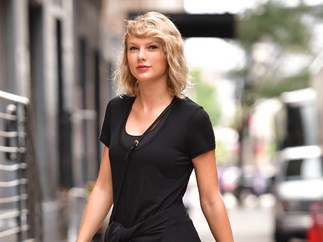 Taylor Swift Sent Flowers to the Company Behind the Sweet Post-it Signs You Saw During Her Trial