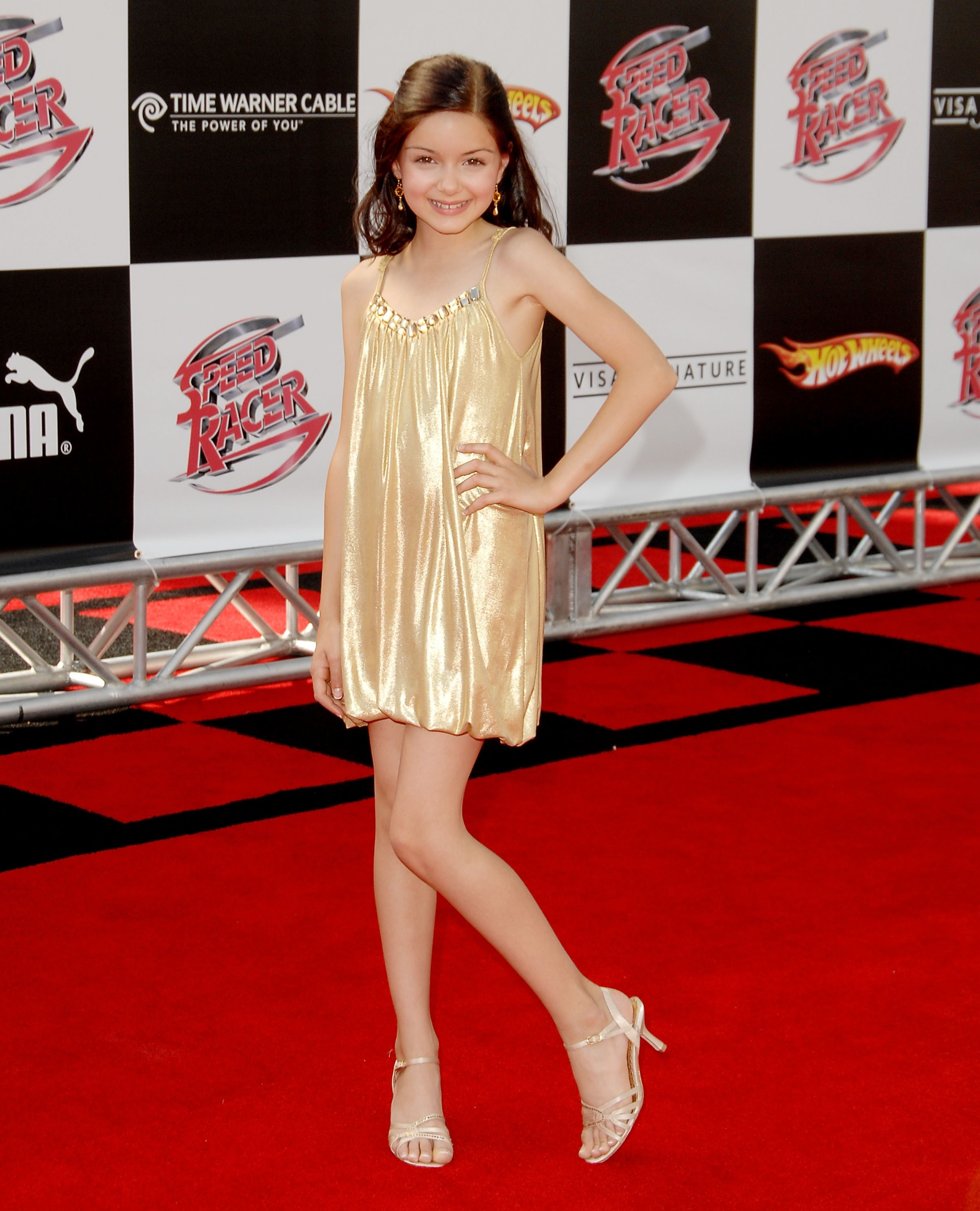 Back in **2008**, when Ariel Winter was just a bubba, she landed a role in the movie *Speed Racer* and rocked the hell out of this gold slip dress and strappy shoes at the premiere. Wish we looked this dayum stylish when we were 10 years old.