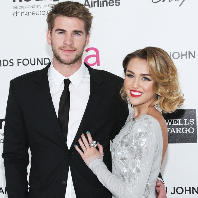 **Miley Cyrus and Liam Hemsworth:** After getting engaged in 2012, Miam called it quits following Miley's ~infamous~ *We Can't Stop* performance at the MTV VMAs... yep, the one with Robin Thicke. Thankfully, the two sorted things out after a two-year break and are FINALLY back together! WOO!