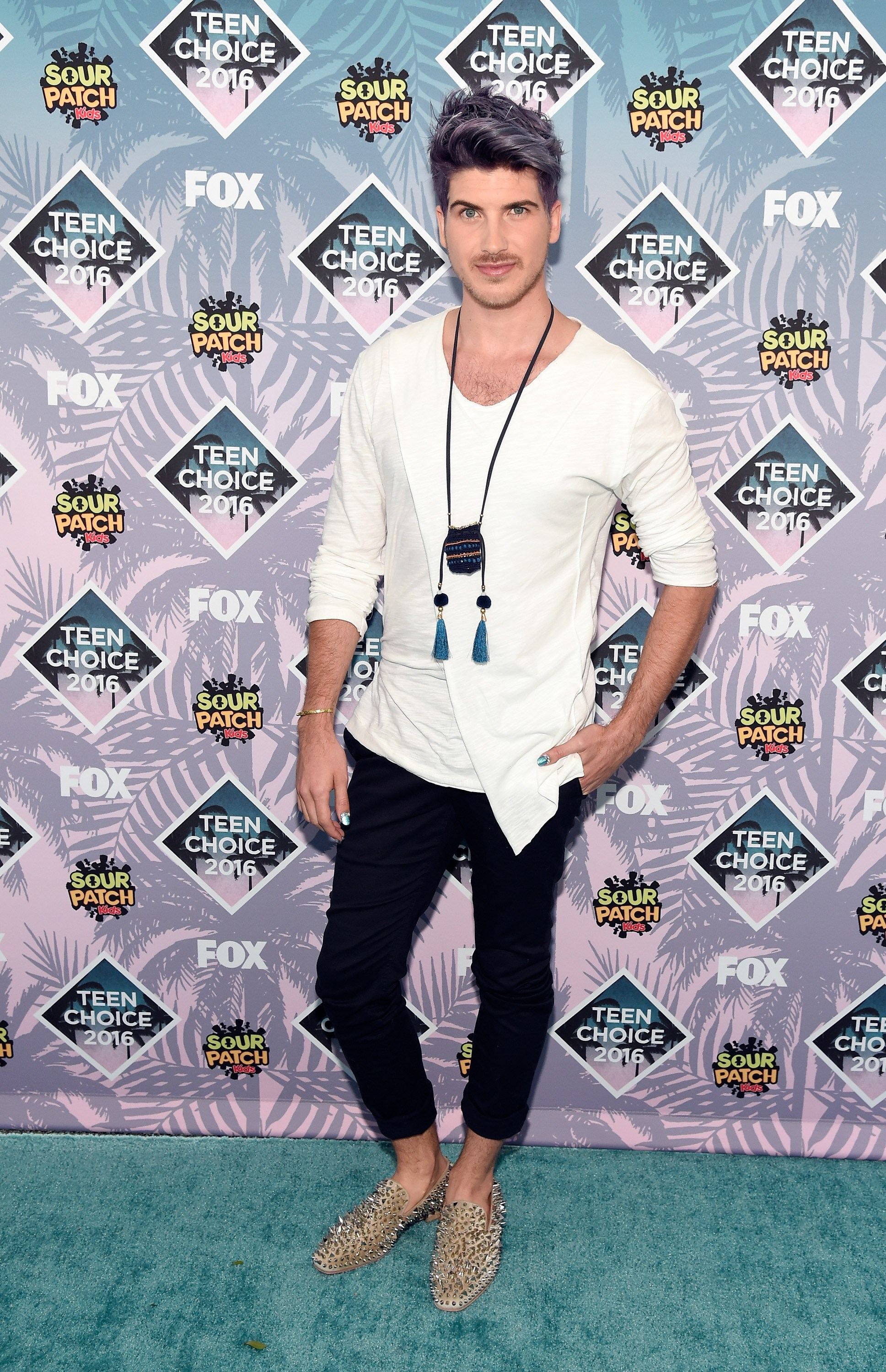 **Joey Graceffa's** hair, shoes and necklace totally complement his simple black-and-white get up.