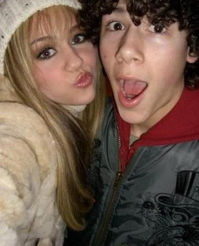 "**Nick Jonas:**  ""The first person I kissed was Miley Cyrus and I kissed her outside of California Pizza Kitchen in Hollywood — very romantic. I'd just had a pizza that had onions all over it, I'm sure that my breath smelt terrible. I don't know [if she'd remember my breath smelling]. I'd have to ask her. But I'm sure she does — it was probably pretty potent,"" he said."