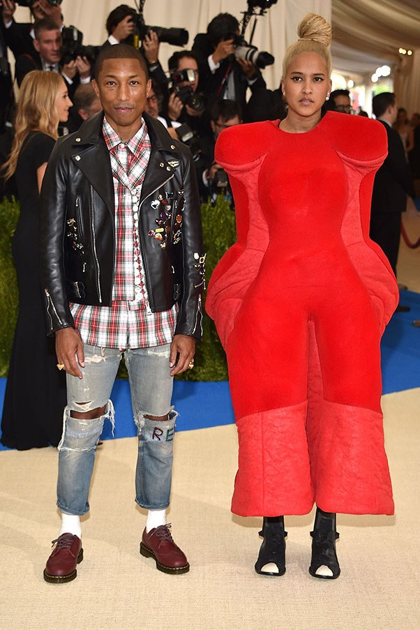 Pharrell Williams and Helen Lasichanh, both in Comme des Garçons.