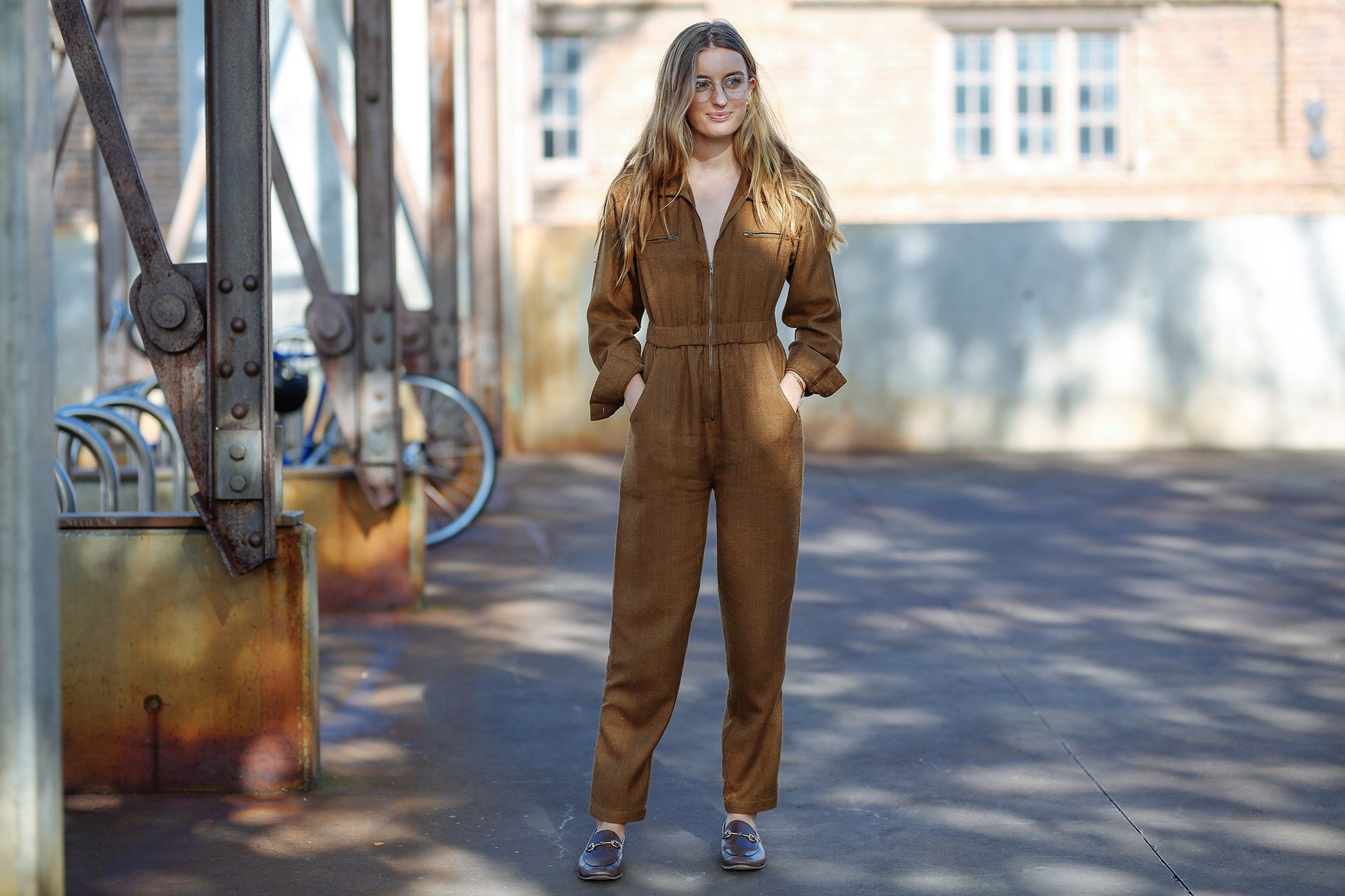 """ELLE Market Editor, Claudia Jukic wears Doen jumpsuit, Gucci shoes, Vintage earrings and [Giorgio Armani](http://www.opsm.com.au/) glasses. """"I love a head-to-toe tonal feel, and I particularly love when my specs work in the colour scheme too."""""""