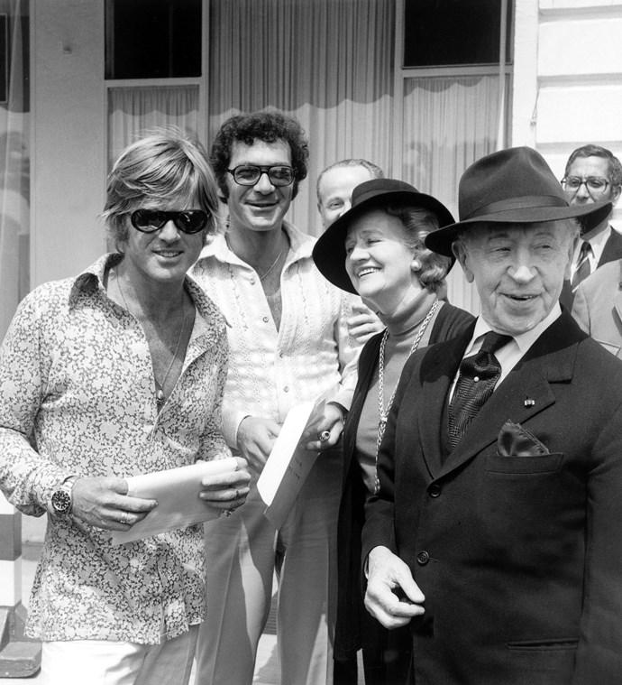 **ROBERT REDFORD, SYDNEY POLLAK, ANIELA MLYNARSKA, AND ARTUR RUBINSTEIN, 1972**  Robert Redford, HOT AF.
