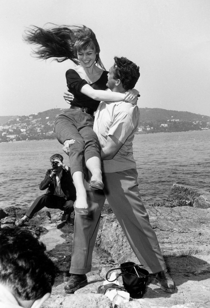 **BRIGITTE BARDOT AND CARL MOHNER, 1955**  Brigitte Bardot really knew how to make the most of a photo op.