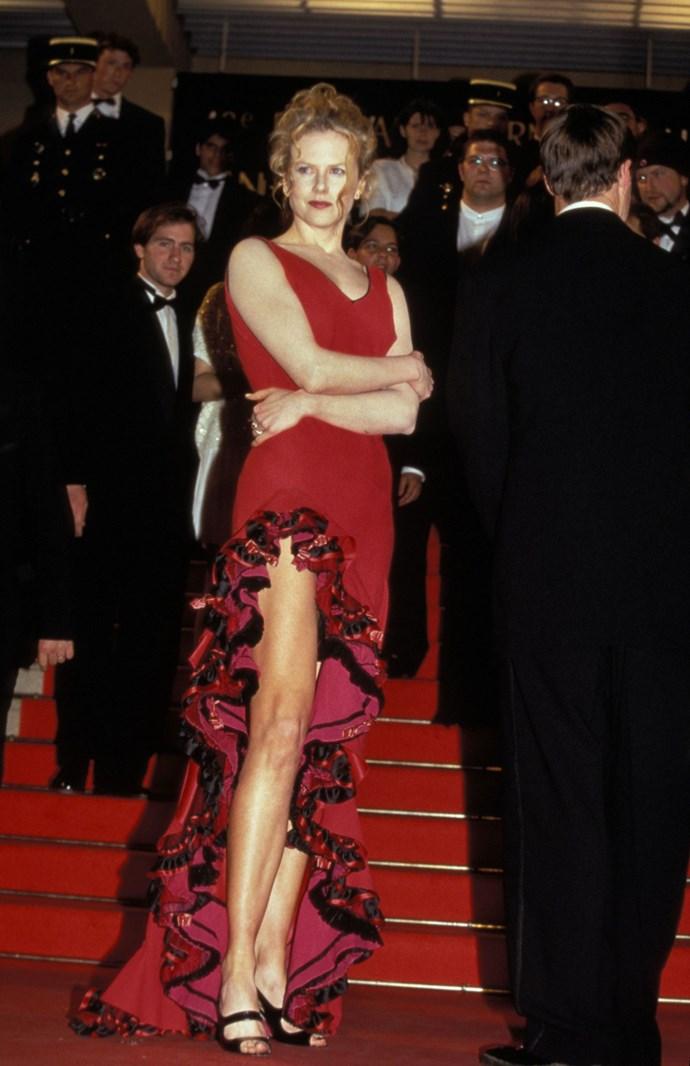 **NICOLE KIDMAN, 1996**  That time Nicole Kidman dressed just like the red dress lady emoji.