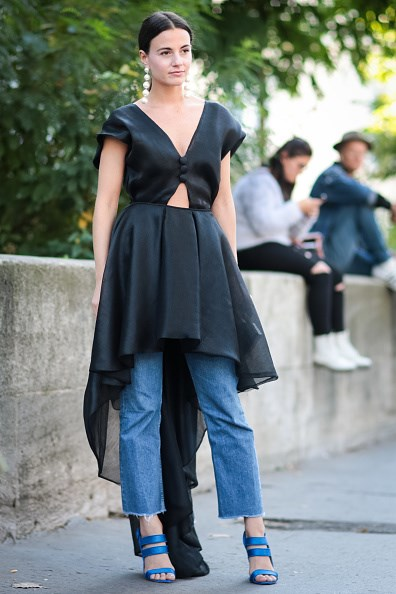 **ZINA CHARKOPLIA**  Little-worn gowns are given a new lease of life when placed over a pair of raw-hemmed jeans. Instagram influencer Zina Charkoplia's silk dress has taken black-tie to lunch hour, with the help of a pair of well-worn denim crops.