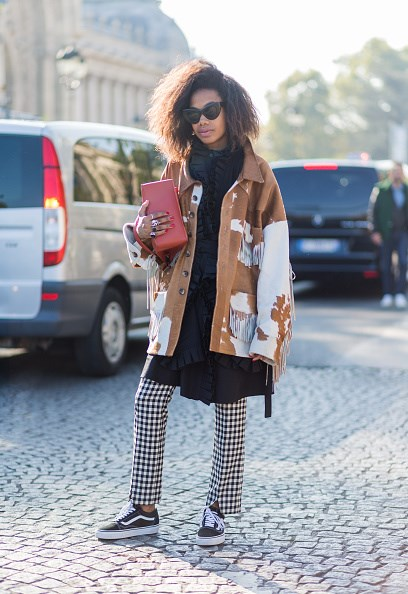 **JAN-MICHAEL QUAMMIE**  Try a tomboyish approach like stylist Jan-Michael Quammie, by turning your mini dress into a tunic and layering it over graphic trousers. Western-style jacket and Vans optional, but highly encouraged.