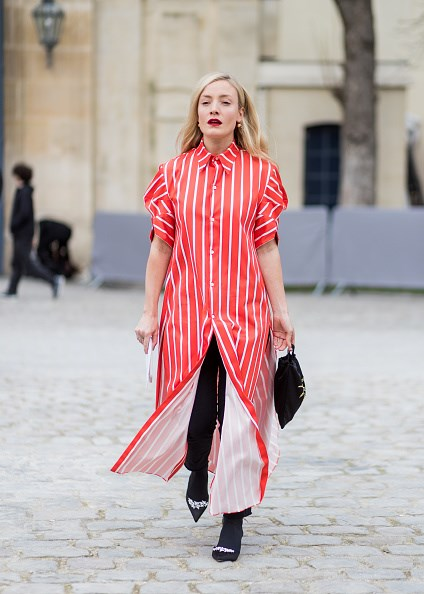 **KATE FOLEY**  Jet black denim, socks and satin Manolo Blahnik mules frame stylist Kate Foley's statement shirt dress to perfection.