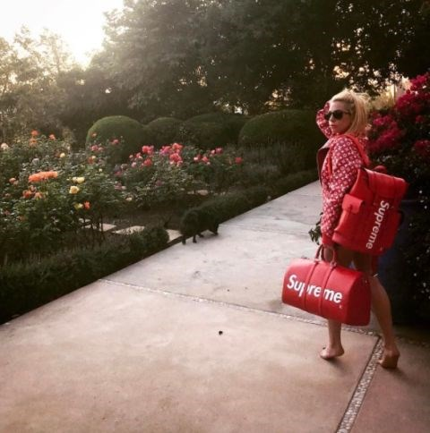 **LADY GAGA** <br></br> Gaga is seeing red this summer, wearing Supreme and Louis Vuitton.
