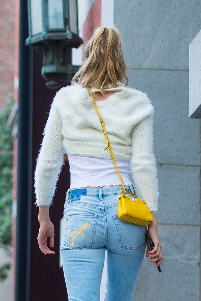 ... His name stitched onto the pocket of her jeans! Sweet.