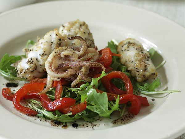 Salt and pepper calamari with roasted capsicum salad