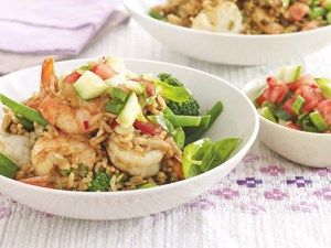 Curried prawn fried rice with tomato and cucumber salad