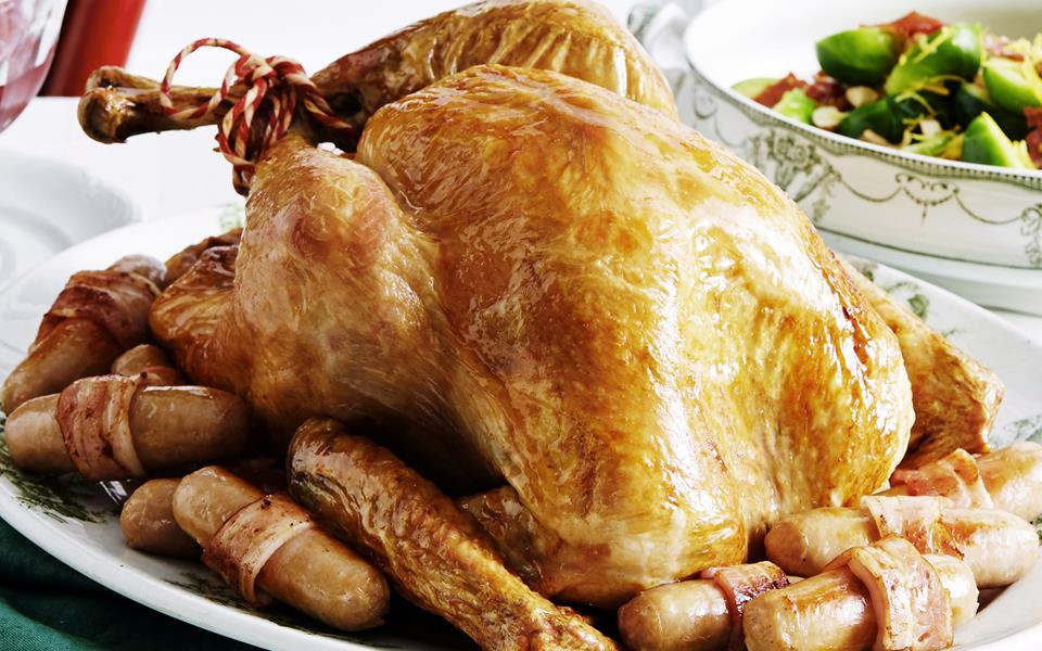Roast turkey with herb stuffing and pork chipolatas recipe for 3 8 kg turkey cooking time