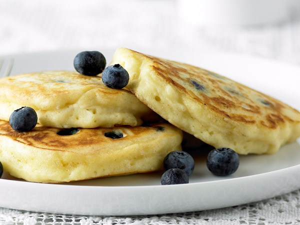 Fluffy pancakes with blueberries and maple syrup