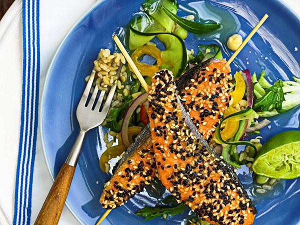 Sesame salmon skewers with brown rice salad