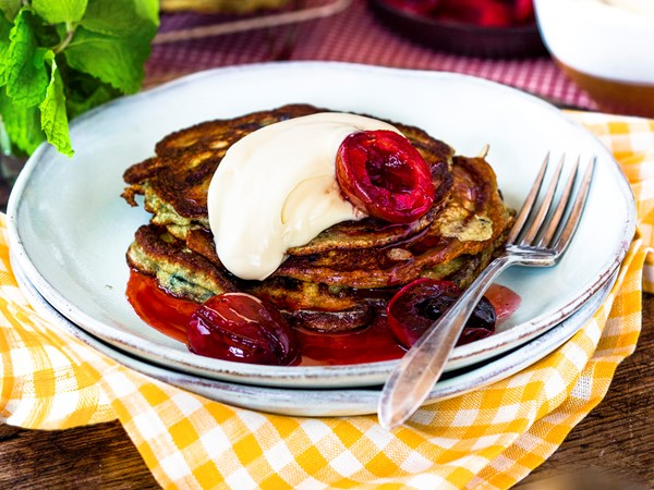 Wheat germ pancakes with roasted plums and maple crème fraîche