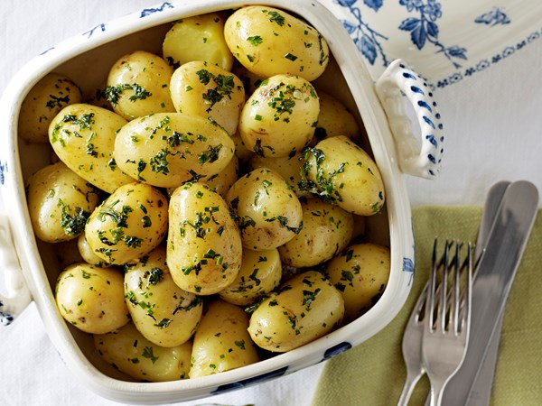 Boiled new potatoes with minty herb butter