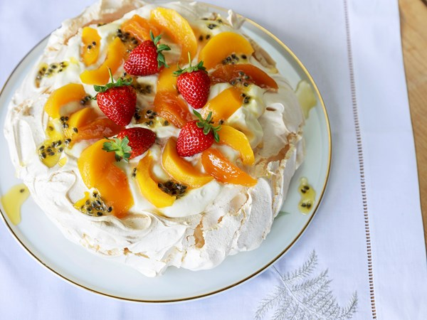 Classic pavlova with spiced peaches and preserved passionfruit