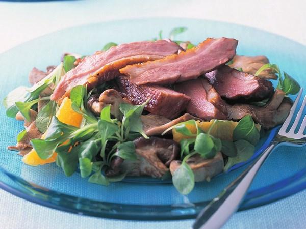 Warm duck, orange and mushroom salad