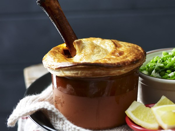 Lamb shank pies with crushed peas and fetta