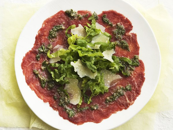 Carpaccio with shaved parmesan and basil salsa verde