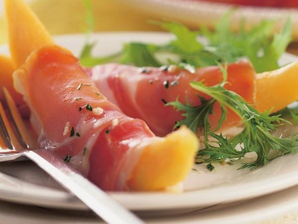 Prosciutto-wrapped melon with vinaigrette