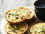 Onion and smoked cheddar tarts
