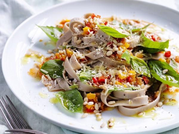 Spelt pasta with braised capsicum, nuts & chilli
