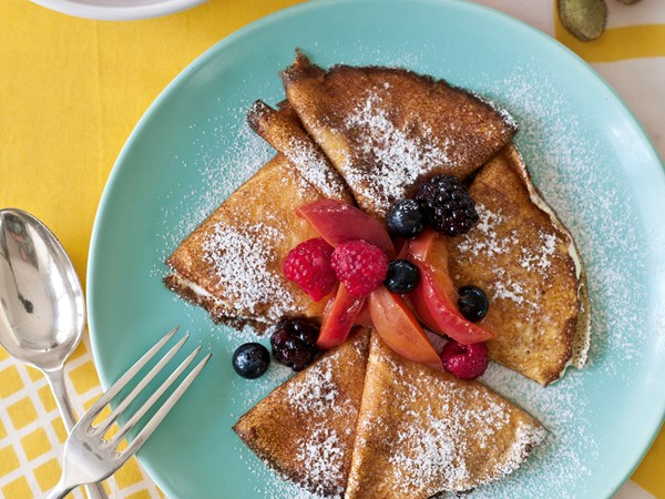 Pancakes with poached stone fruit & berries