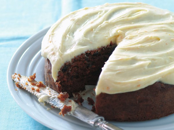 Gluten-free carrot cake with orange frosting
