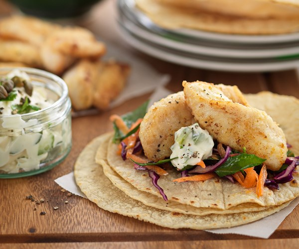 Lemon pepper fish tacos with tartare sauce and coleslaw