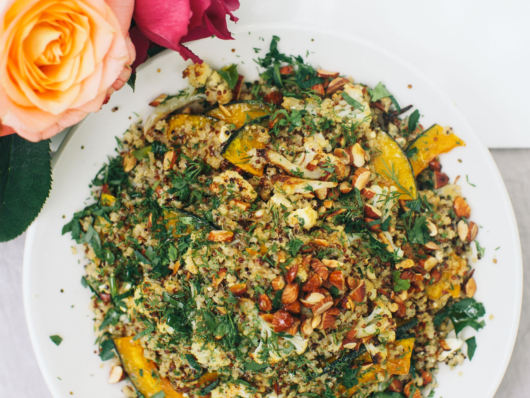 Quinoa and buttercup salad with tahini and pomegranate dressing