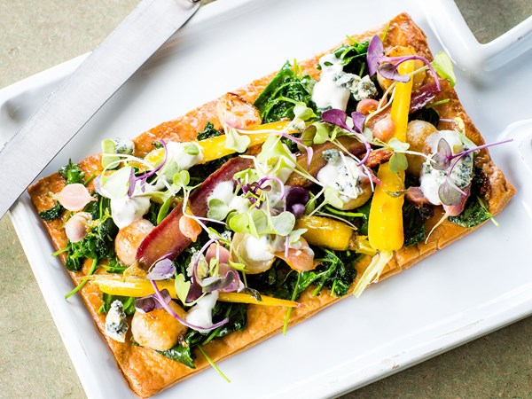 Glazed baby vegetable tart with creamy blue-cheese topping