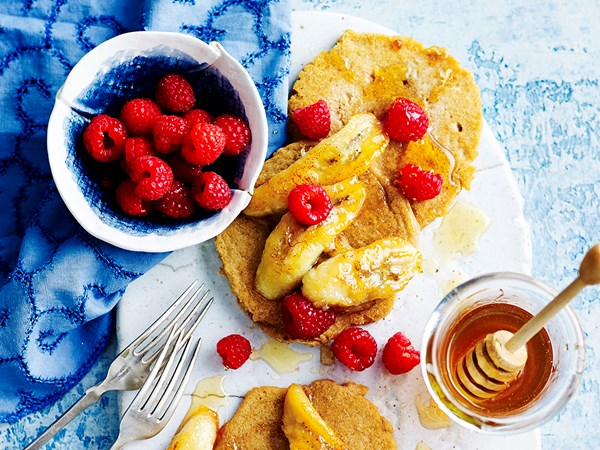 Gluten-free pancakes with grilled honey bananas and raspberries