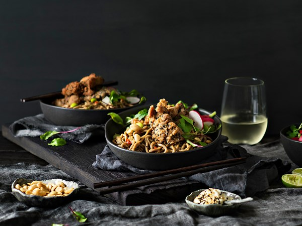Warm soba noodle salad with crispy sesame chicken
