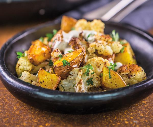 Roasted potatoes and cauliflower with tahini dressing recipe | Food To ...