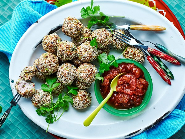 Chicken and sesame balls with sweet and sour sauce