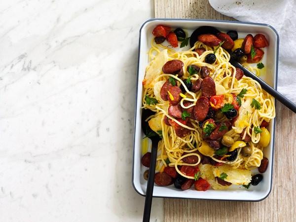 Fresh spaghetti pasta with roasted olives, chorizo and haloumi