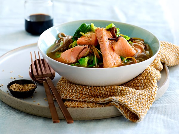 Salmon noodle soup with wild mushrooms, greens and toasted sesame