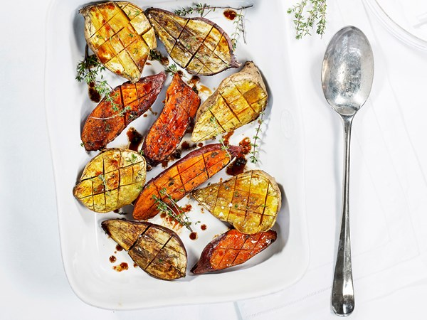 Roasted kumara with cinnamon, thyme and pomegranate drizzle